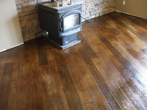 Stamped Concrete Looks Just Like Wood Only More Durable With No Grout Concrete Wood Floor Concrete Stained Floors Inexpensive Flooring