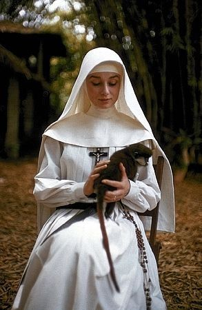 'The Nun's Story', 1959 - Audrey Hepburn as Sister Luke in the Belgian Congo with a tame monkey for company.