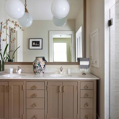 bathroom cabinets painted a taupe color.   painting