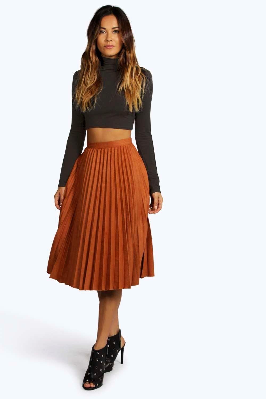 d03192cb83d Faldas midi plisadas: moda para todo tipo de cuerpos | Skirts ...