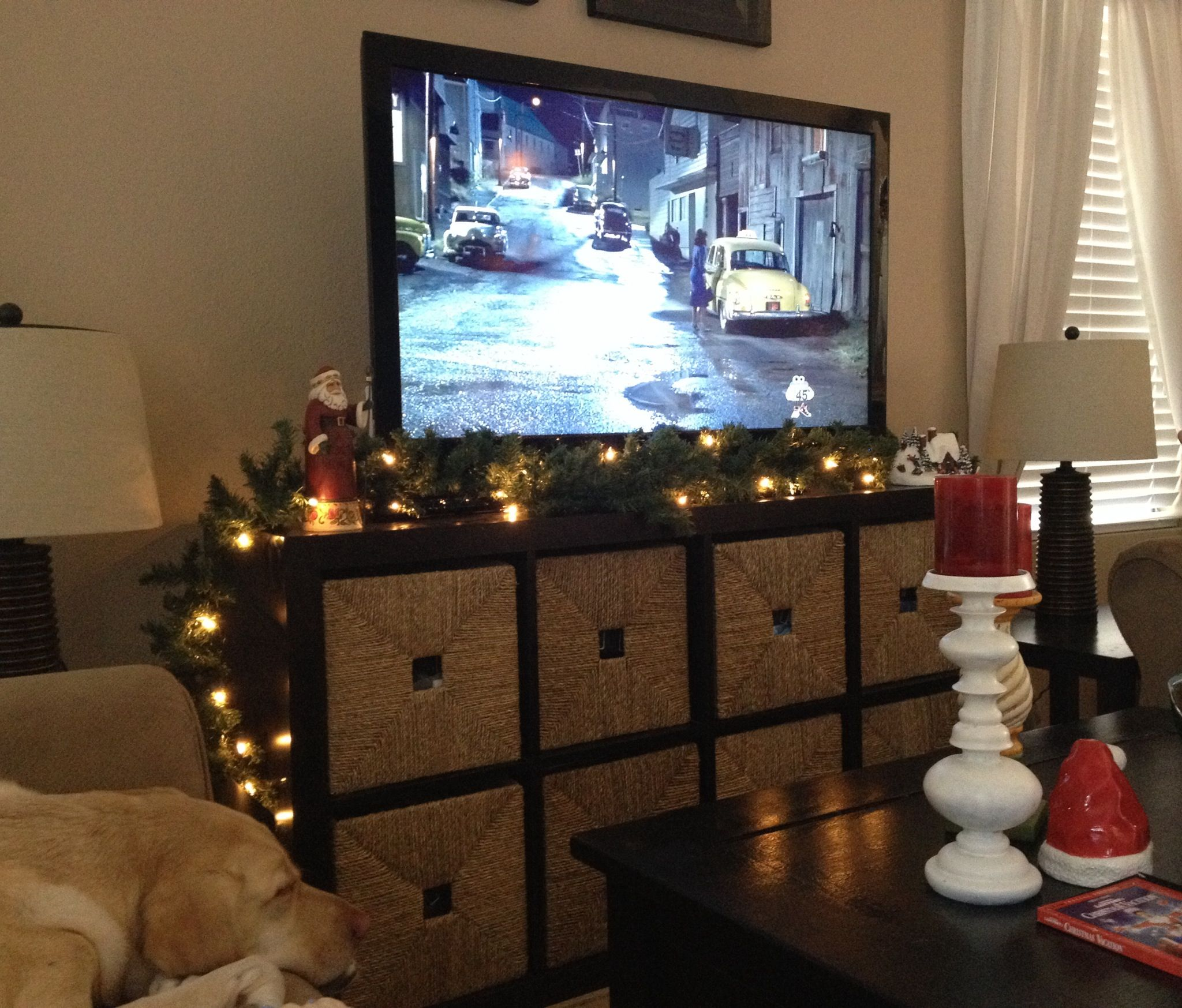 don 39 t have a fireplace to decorate with garland i used our tv stand christmas ideas. Black Bedroom Furniture Sets. Home Design Ideas