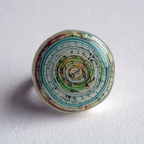 Paper Coiled Stratum Map Ring, by robayre http://www.etsy.com/listing/76643361/ made using a real vintage world map and graph paper