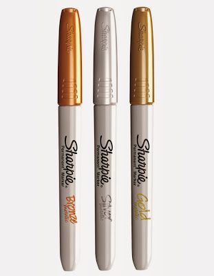 use the metallic Sharpie markers in gold, silver and