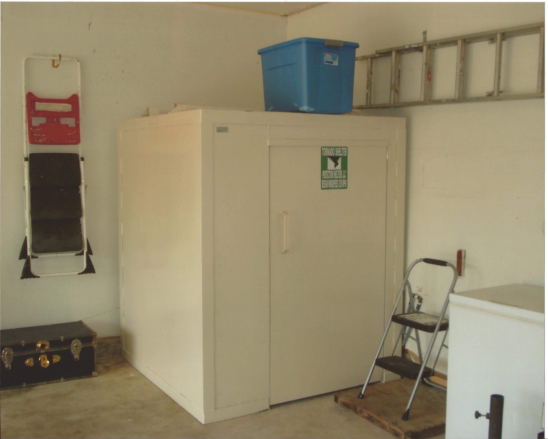 Above ground steel garage shelter storm shelter home
