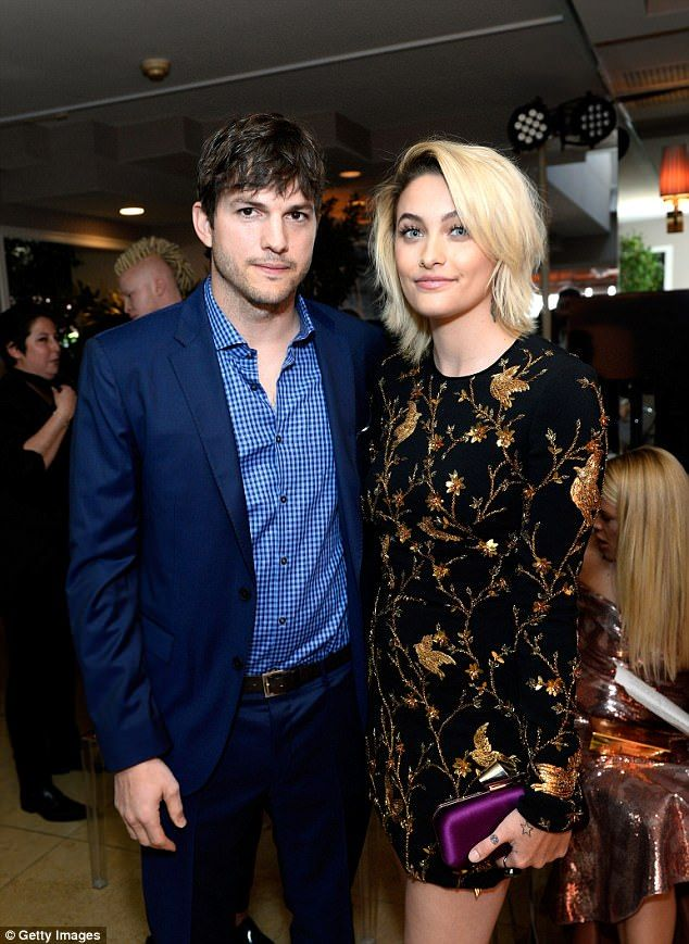 Mila kunis stays home while ashton kutcher joins paris jackson in meet and greet just hours later ashton was seen at the fashion los angeles awards where h m4hsunfo