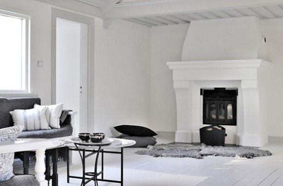 Sheepskin Rug And Pillows In Front Of The Fireplace Sweden