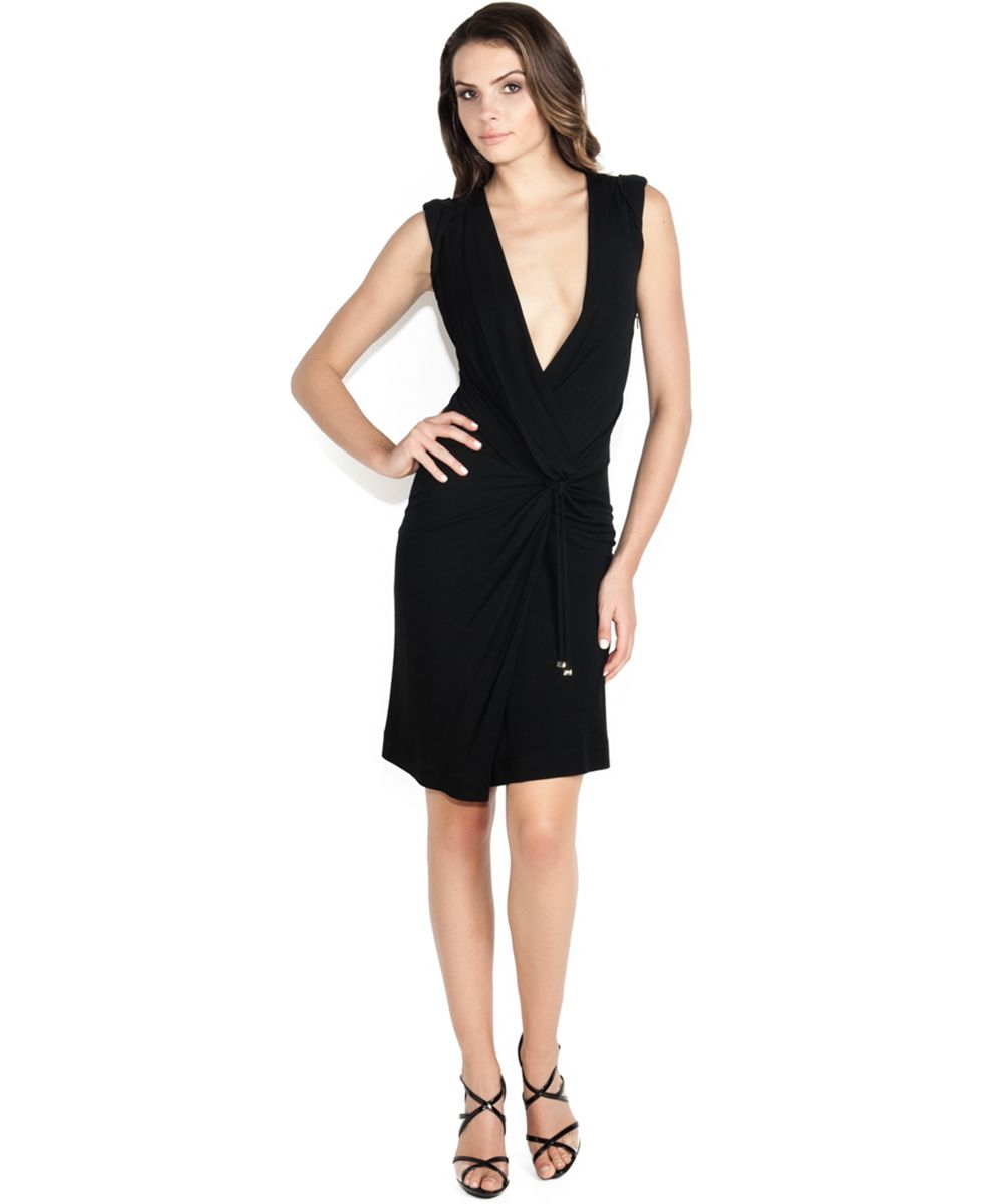 Gucci s black wrap dress transitions effortlessly from office to  after•hours. Wrap dress comes with self tie option at waist. The plunging V• neck opening 7db9dff00