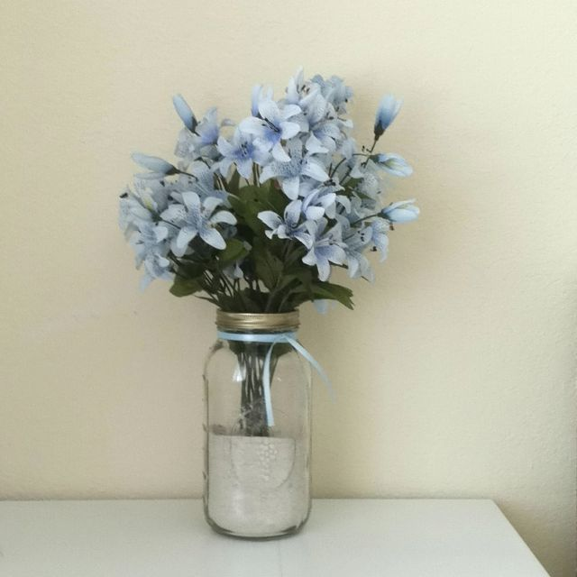 What To Put In Mason Jars For Decoration: Buy Mason Jar, Get Sand From Beach, Buy Blue Ribbon, Buy