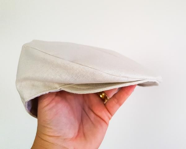 Flat Cap in Ivory Linen This ivory linen flat cap is the perfect little hat for your little boy. I cut and sew each of these hats from a beautiful linen cotton blend fabric in a gorgeous natural ivory. These newsboy style hats are very popular as part of a ring bearer's outfit or first birthday outfit and would also be the perfect gift for a baby shower or a new baby boy.