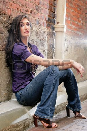 Beautiful Model Sitting And Leaning Against A Brick Wall Beautiful Models Model Poses Sitting Poses