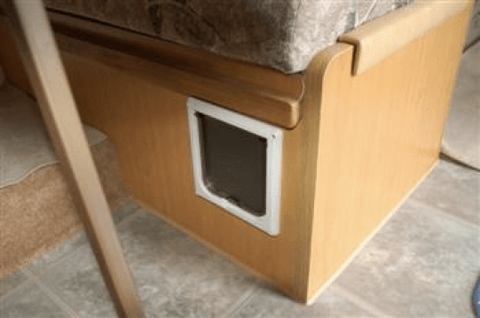 Cat door in side of dining booth - litter box storage idea for RVs campers or motorhomes