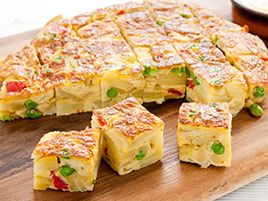 Our meltingly tender Spanish Tortilla with Roasted Red Peppers and Peas is the perfect skillet supper.