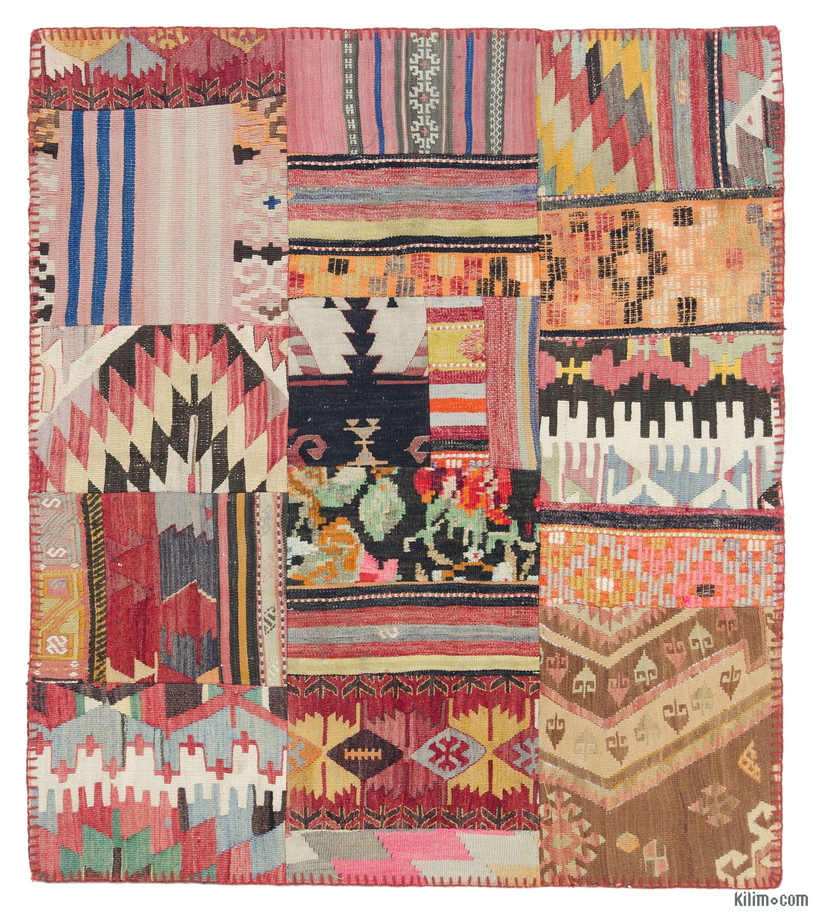 Kilim Patchwork Rug created from pieces of miscellaneous vintage handwoven Turkish kilim rugs. This piece is backed with a fabric as reinforcement.