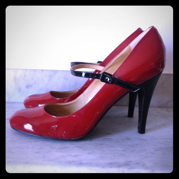 Nine West patent leather Mary Janes Beautiful patent leather red Mary Janes.  Black heel and strap.  Never worn outside. Nine West Shoes