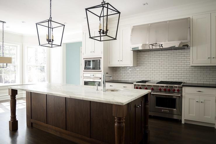 brown kitchen island lovely kitchen features white shaker cabinets paired with 1833