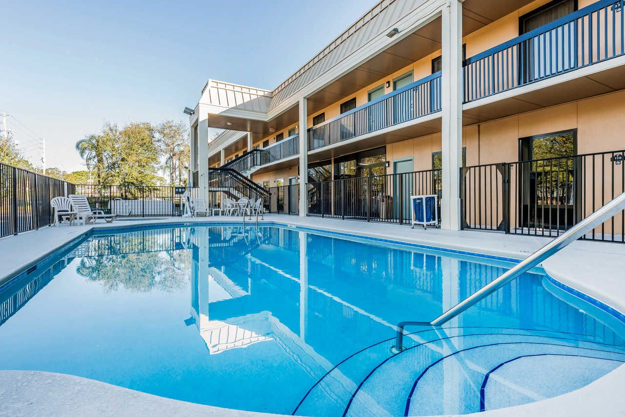 Relax By The Pool Quality Inn Fort Pierce Fl Hotels Hotel Florida Hotels House Of Seven Gables