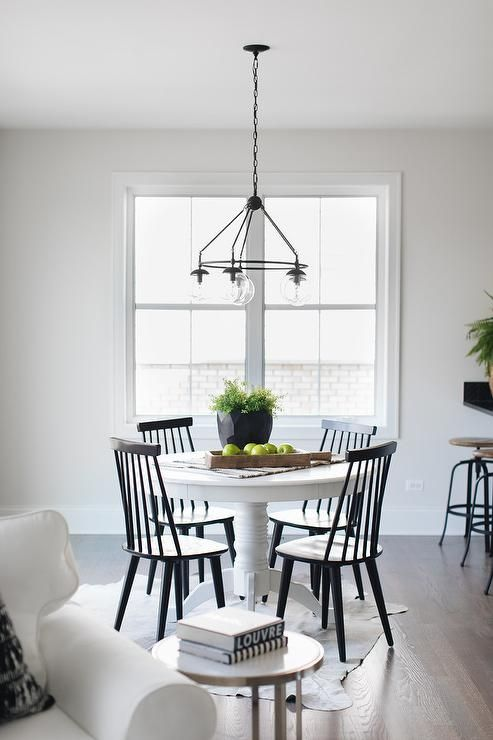 Pairing Black Windsor Chairs With A Round White Pedestal Dining Table Binds An Antique Feel White Round Dining