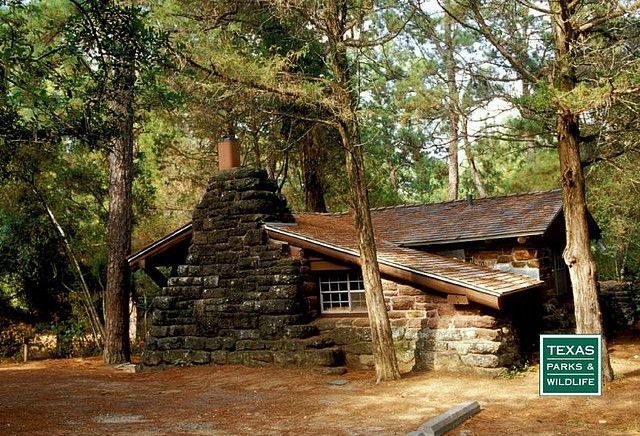 The historic stone cabins nestled in the woods of bastrop for Texas cabins in the woods