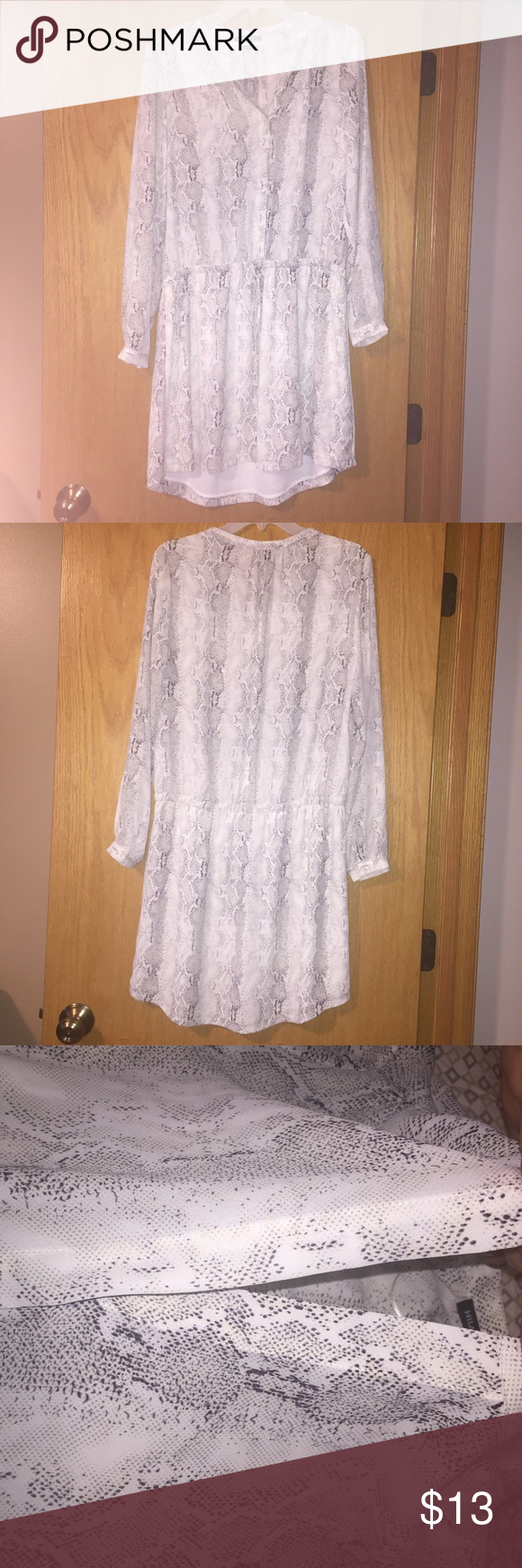 Hilary Radley tunic dress long sleeve speckled Beautiful Tunis dress.  Lightweight.  Long sleeve.  Only the skirt is lined. Top is not lined.  Half way hidden button  up. Button sleeves. White with Planck speckles. Tie at waist.  New without tag.  Tried on only, too big for me 🙃 Dresses Long Sleeve