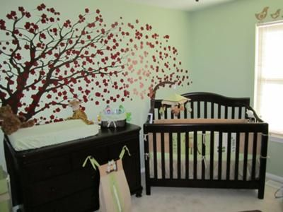mystical forest baby nursery theme the babys room has its own cherry tree wall mural surrounded with baby deer birds and other woodland creatures