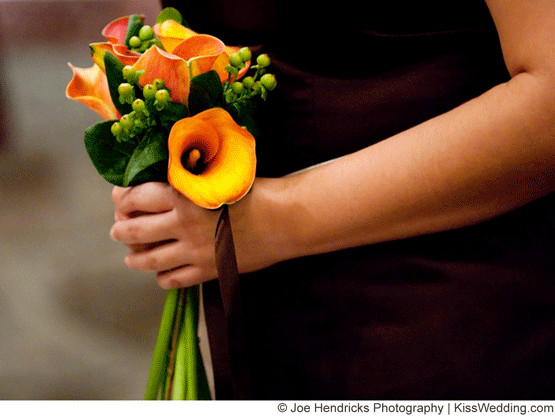 a small orange calla lily bouquet for a fall wedding