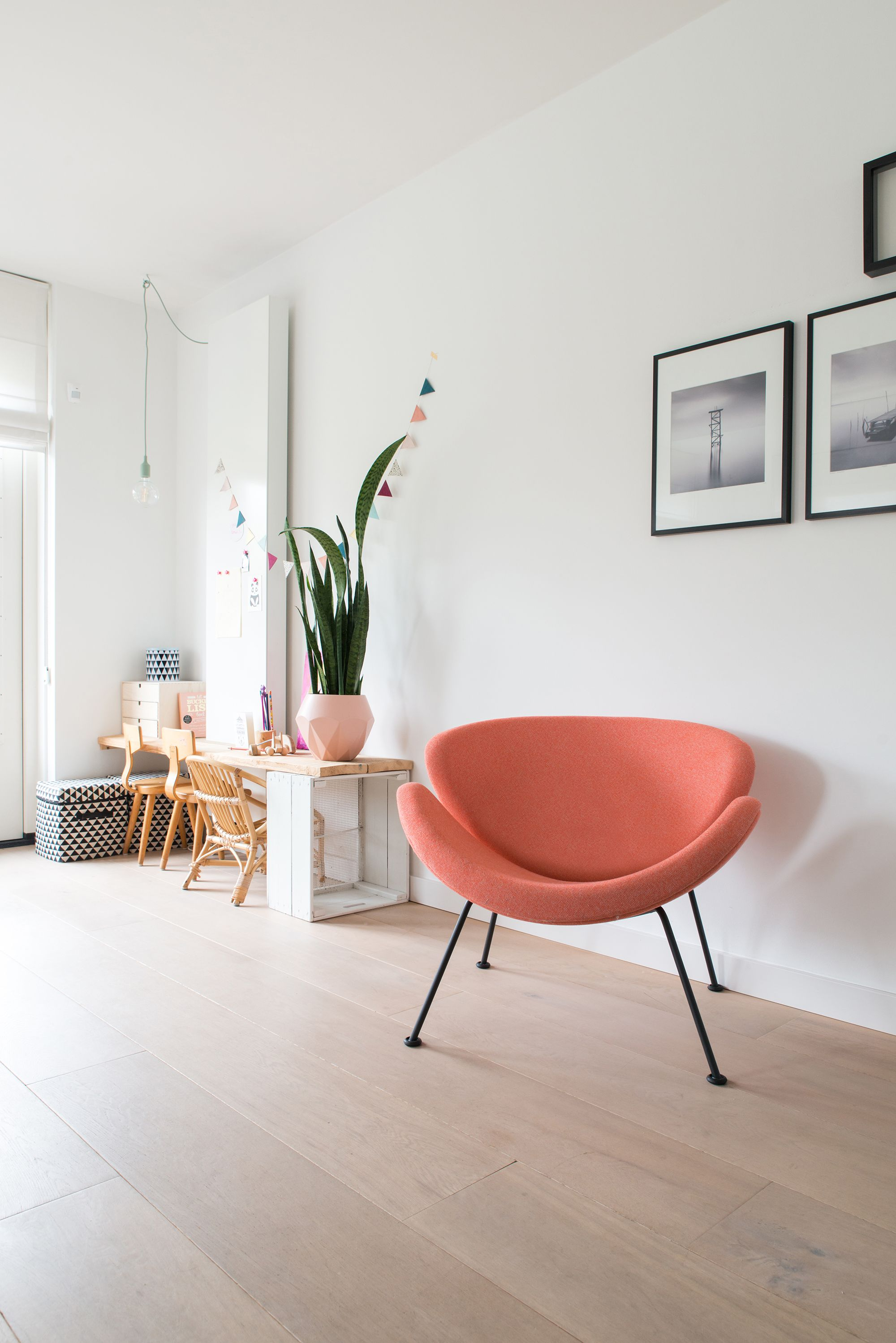 This pink Orange Slice armchair brings color to this living room ...