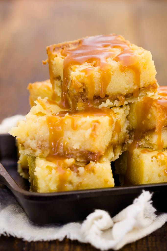 """There are a few types of gooey butter bar (or as we say here in St. Louis, gooey butter cake) bakers: those who make yeasty cake-like gooey butter bars, those who prepare a """"cheater"""" version made with cake mix and cream cheese, and those who bake a from-scratch version made with evaporated milk. I prefer …"""