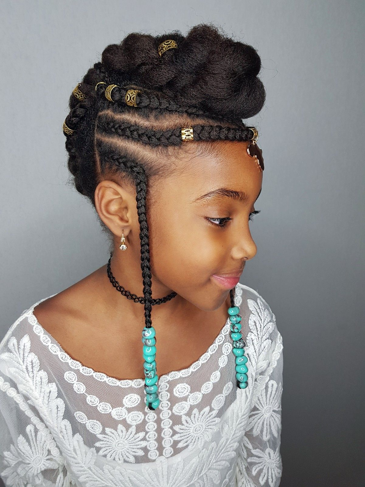 Fulani inspired hairstyle for kinky haired girl natural hair