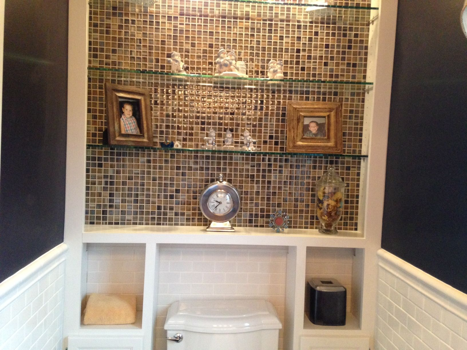 With The Help Of My Brother Ron, I Updated The Powder Room With Some Glass  Tile And Built In Cabinets Around Toilet.