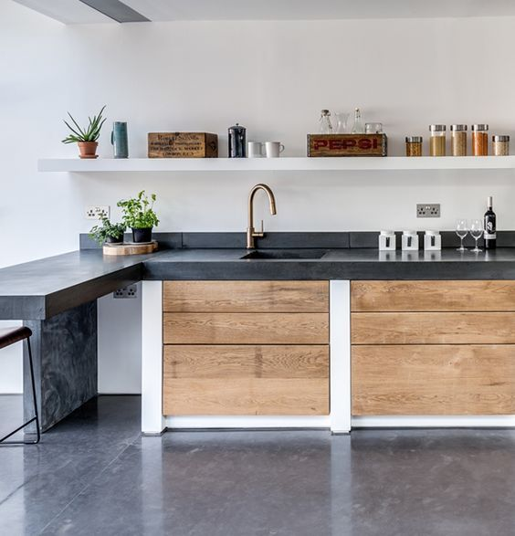 Polished concrete floors, worktops with sink and step Paper House Project commissioned Lazenby to help transform this home. This comprehensive refurbishment features Lazenby's polished concrete throughout.: