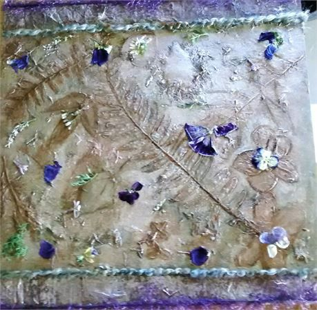 Bring a bit of nature into your home with this subtle and lovely 12x12 botanical hanging wood panel.   Here I have taken dried and pressed flowers and leaves and combined them with soft paint colors such as bronze, sage and lavender. I added a touch of royal blue in the flower petals used for added contrast. I framed the piece in royal purple and sage green textiles and it will come to you ready to hang. On my monitor, the first three pictures represent a more accurate color portrayal than…