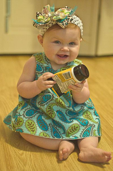 Adorable outfit and a precious model, if i do say so myself! Reversible Open Back Baby Dress by GrammysGetUps on Etsy, $30.00