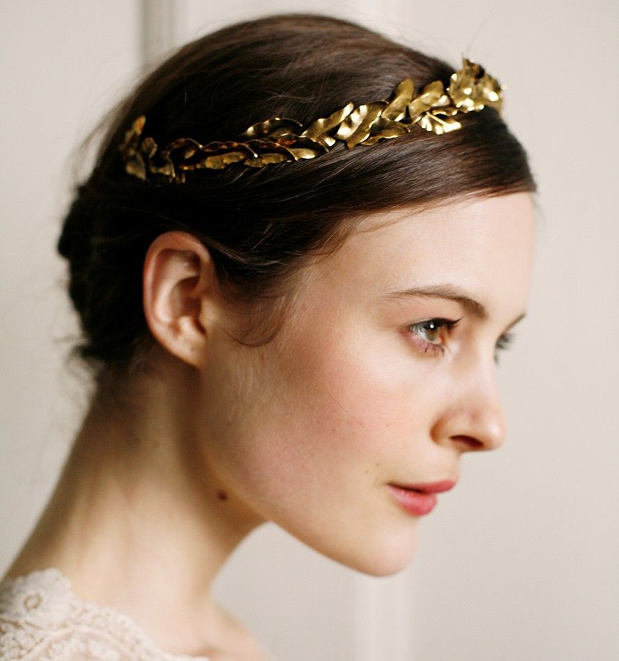an arcing halo of vintage brass leaves. the tiara rests