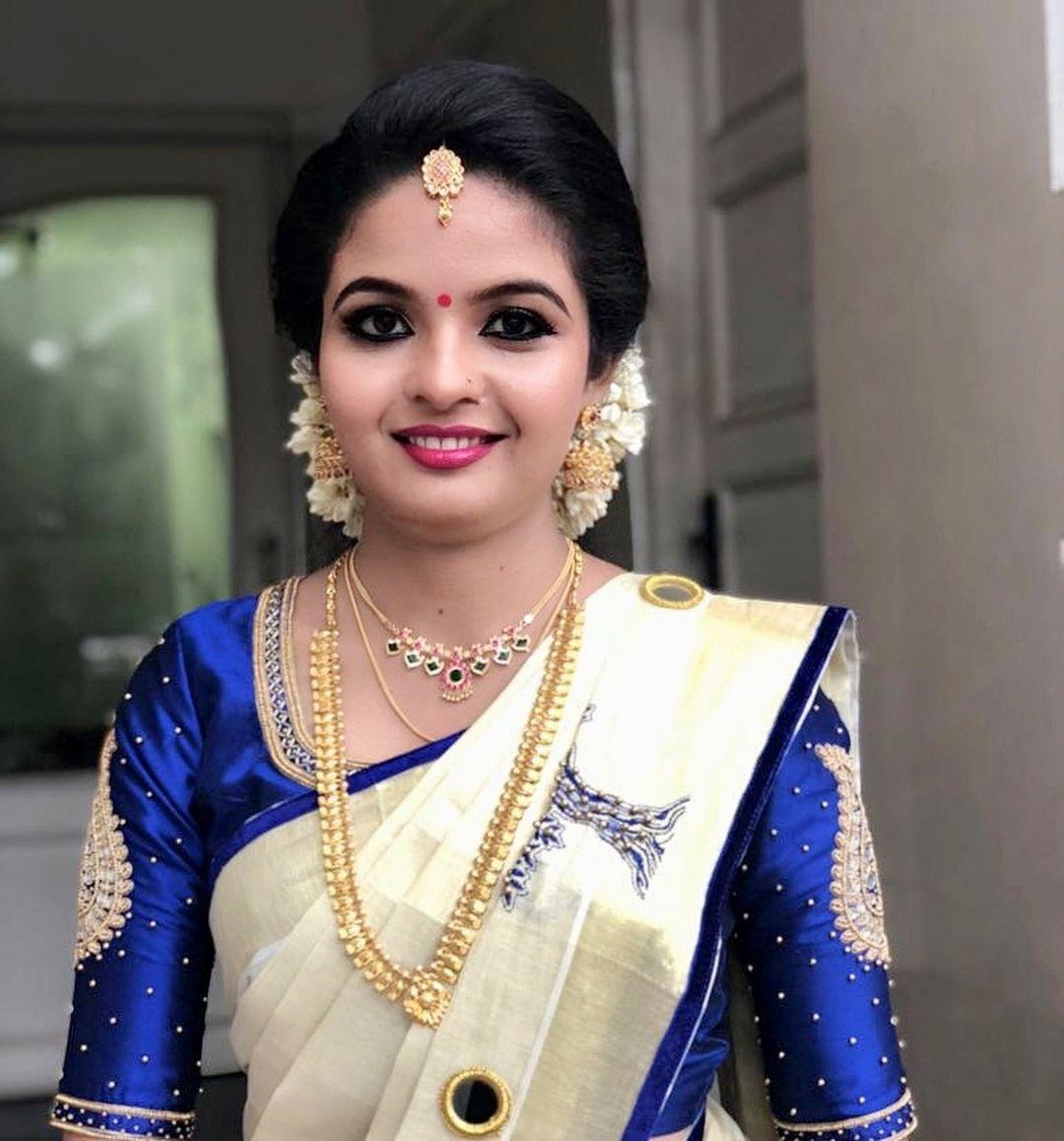 Dr Aiswariya Harikumar Makeup For The Marriage Ceremony Of Tying The Ritual Thread Thaali I Saree Hairstyles Kerala Saree Blouse Designs Kerala Saree Blouse