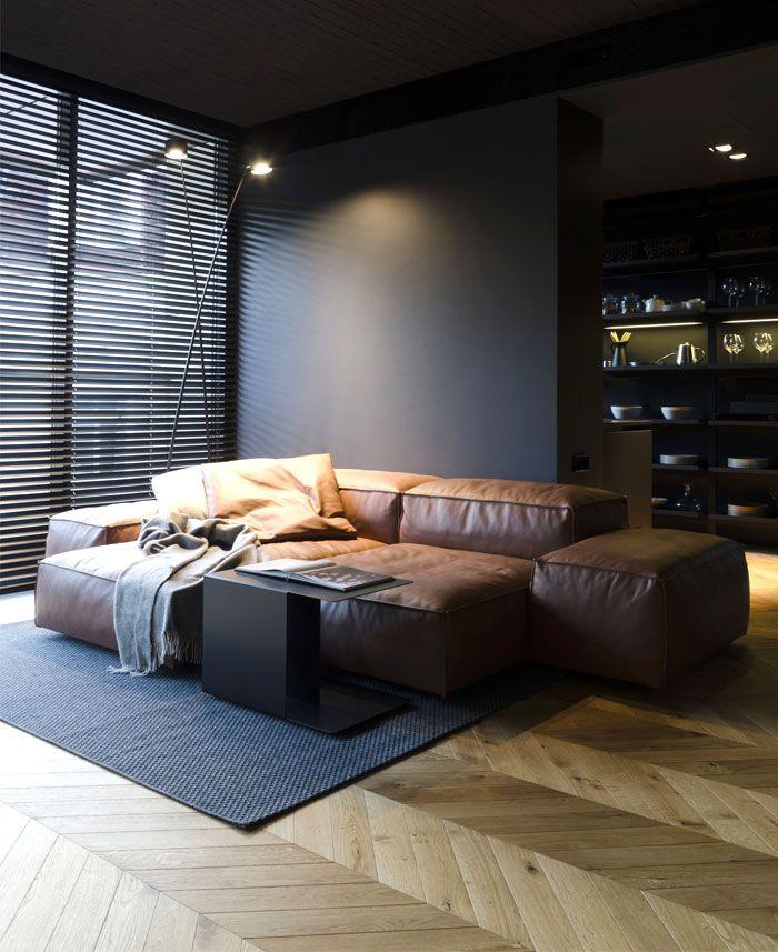 Small Masculine Apartment In Dark Color Schemes White Interior
