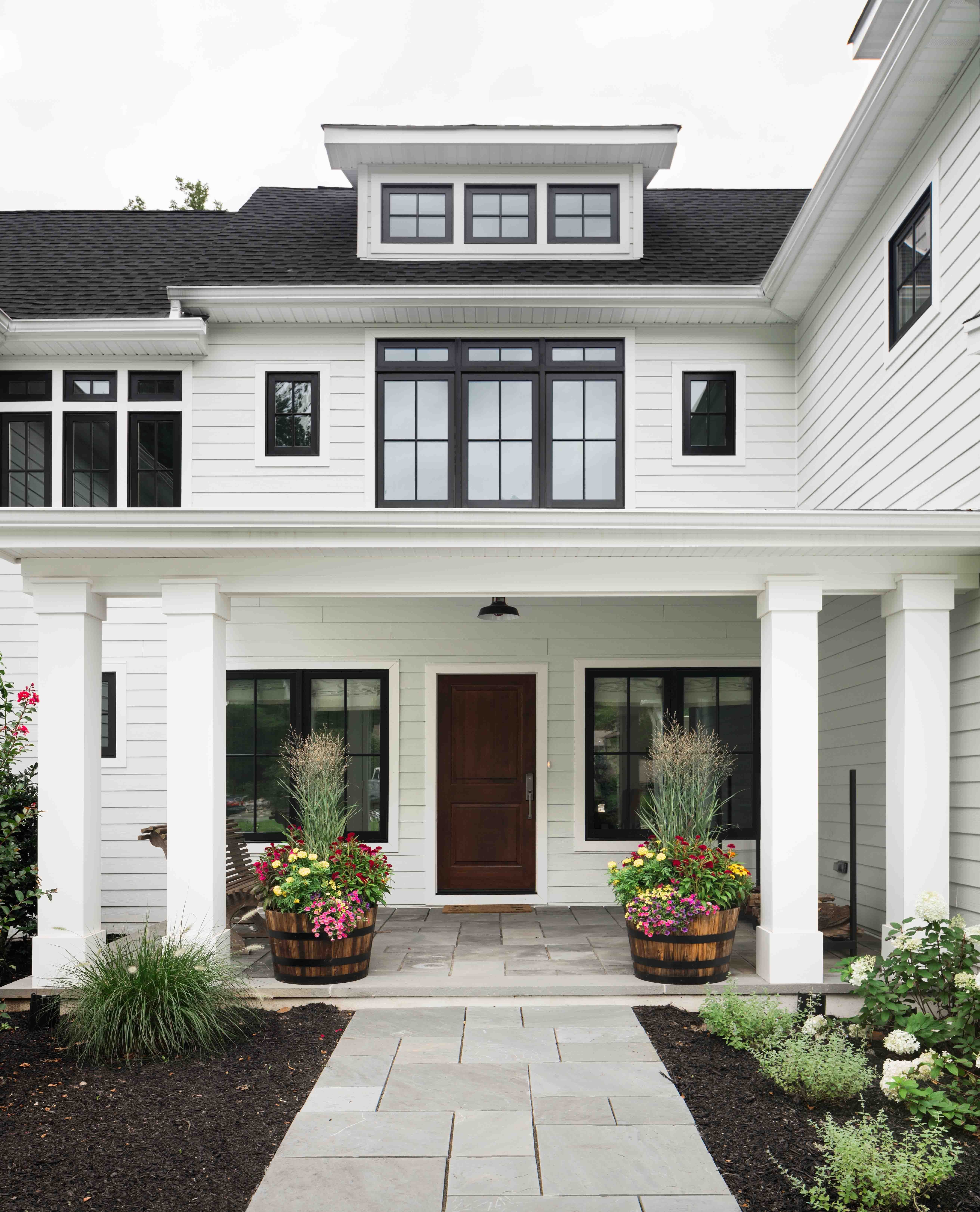 Z architects residential architecture exterior front yard geometry windows gable home entry curb appeal porch modern farmhouse