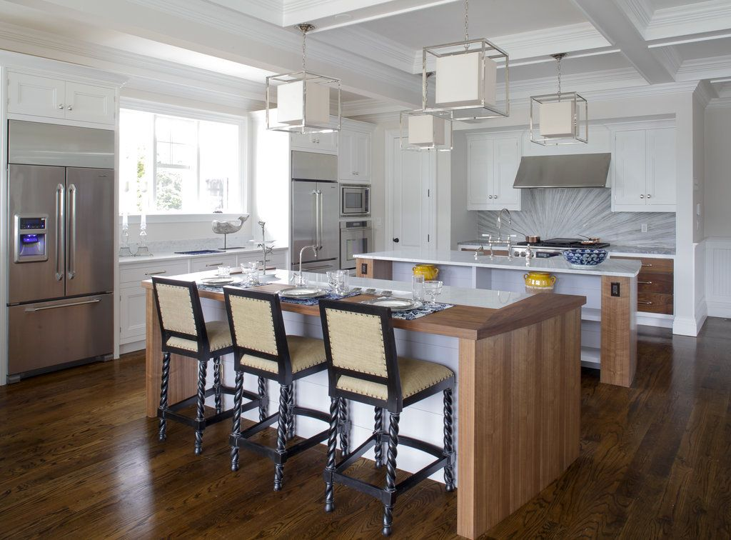 2 islands, 2 sinks, 2 fridges, 2 ovens and 4 lights!  Wondering if there are 2 dishwashers?
