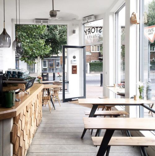 light oak wood tables with pale tones in the ceiling and floor create an airy and inviting atmosphere the perfect scandinavian cafe for enjoying fika - Light Hardwood Restaurant Decoration