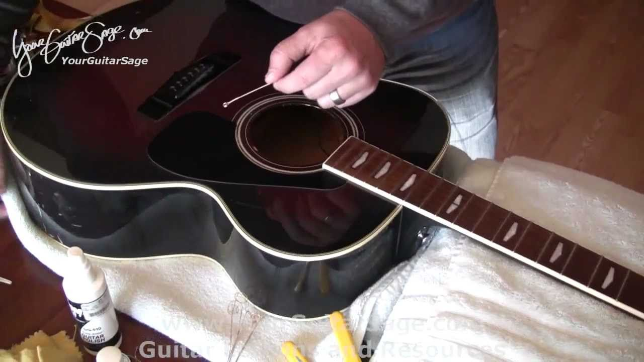 Changing strings on an acoustic guitar part 1 easy