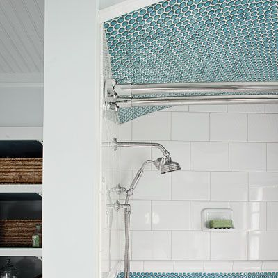 The Tub Enclosure Is Set Off By A Lowered Arched Ceiling Lined With Blue Penny Rounds Which Are Repeated In An Accent Border Around Walls