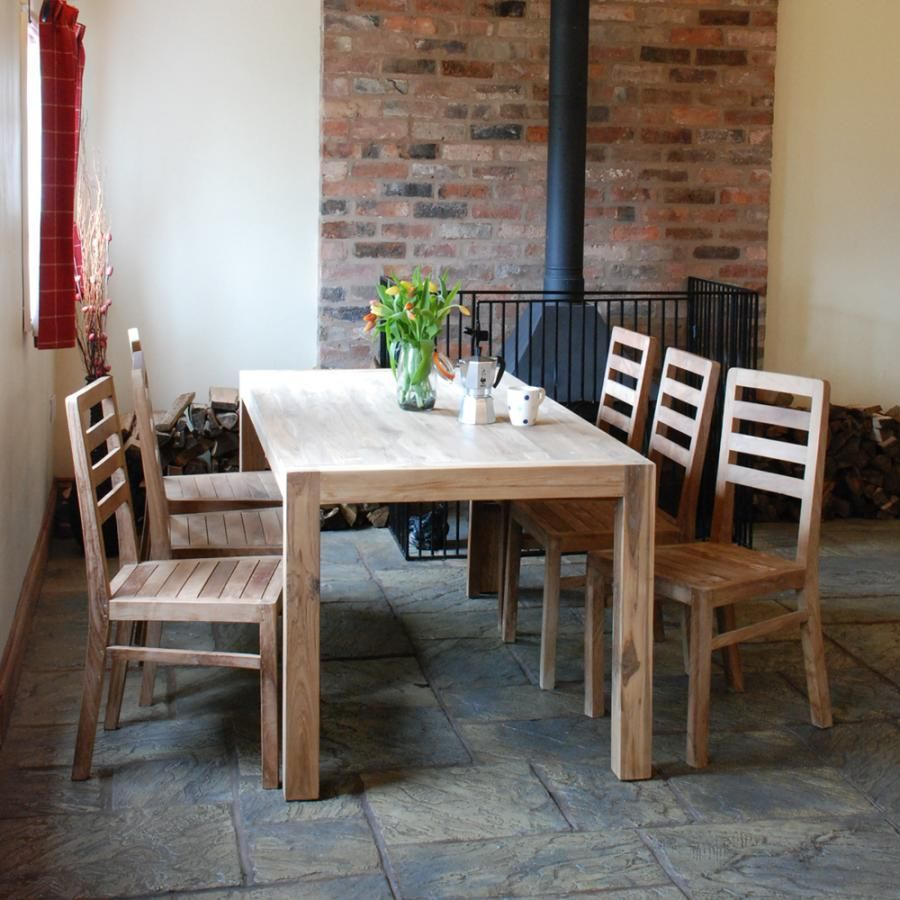 kitchen:wooden dining table and chairs brick walls red curtain