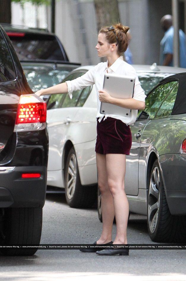 89fe8970928 Emma Watson flaunts long legs in maroon velvet shorts in New York City