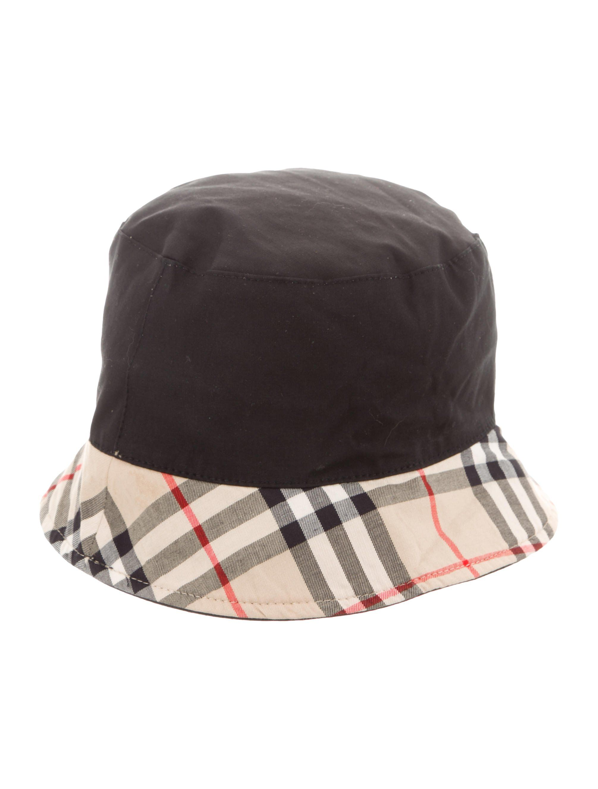 16a2d61637c Tan and multicolor Burberry reversible bucket hat featuring Nova check  print throughout. Designer size M.