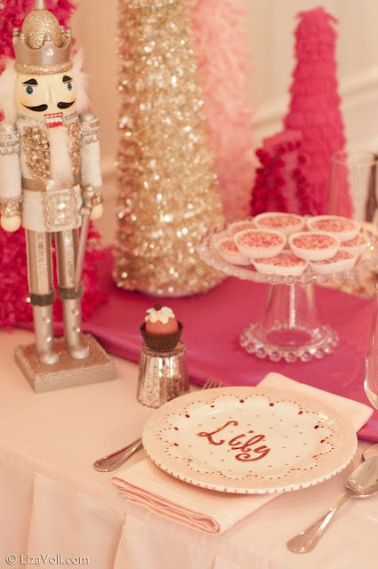 I used the photos from this website/blog Kate Landers Events as inspiration for Bella's 4th birthday party. It was nutcracker themed at her dance studio. These pictures are so great! I think we pulled it off rather well. From the nutcracker, to the favors, the tulle poms and wall decor. Now a lot of the party decor decorates her bedroom walls.