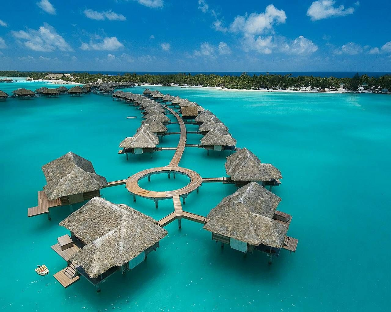 "Recently awarded the title of ""the best island in the world"" the Four Seasons in Bora Bora is a dream location. With gorgeous private bungalows and villas, fine dining and crystal clear water you truly can't go wrong. Once again an expensive spot to stay, but in our well worth considering!"
