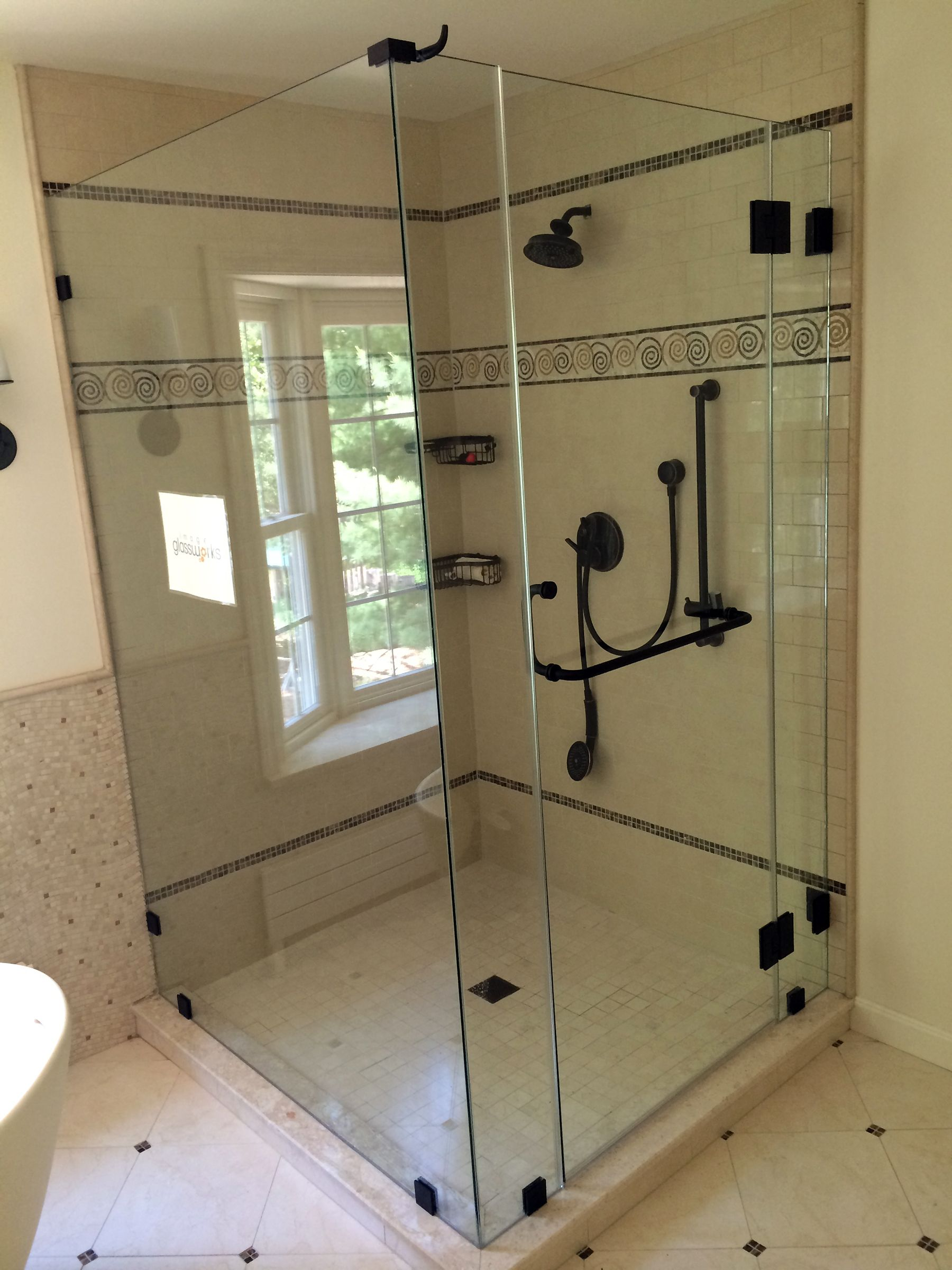 A Beautiful Frameless Shower Door Enclosure With Oil Rubbed Bronze