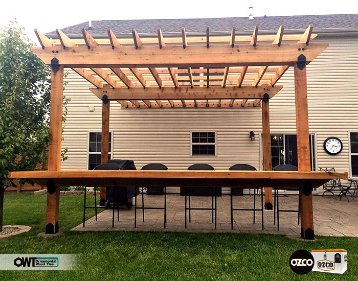 Extended Attached Pergola With A Pull Up Bar For Seating Creates A Great Gathering Outdoor Space Ornamental Wood Ties O Outdoor Pergola Pergola Pergola Patio