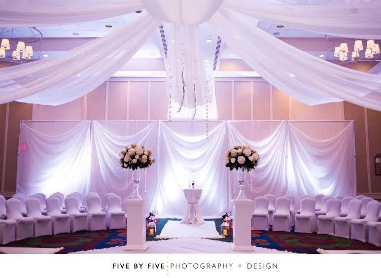 Ceremony in grand ballroom at hilton decor by doug smith