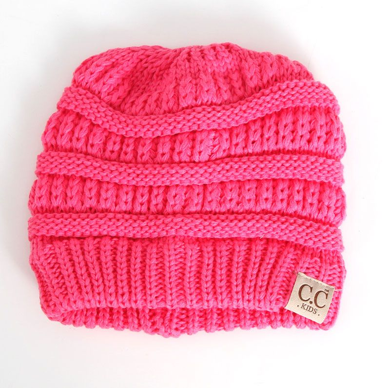 79c3dd72d24 C.C. Beanie Cable Knit Messy Bun Beanie for Girls in New Candy Pink ...