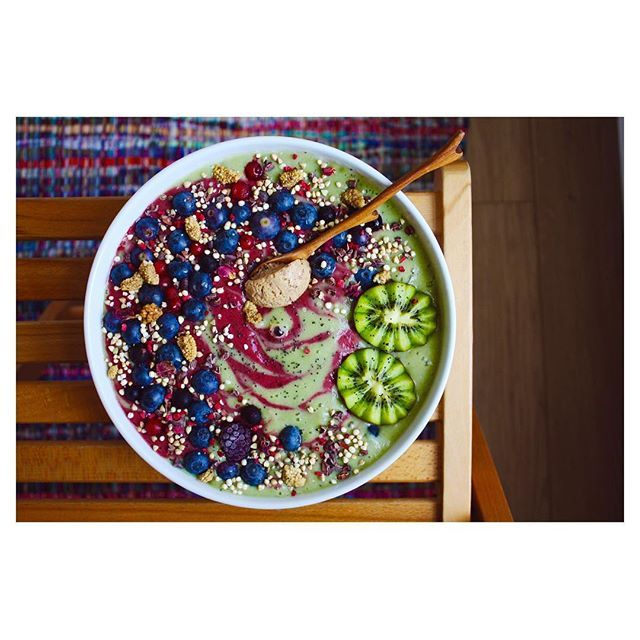 Berry and bok choy smoothie bowl with peanut butter